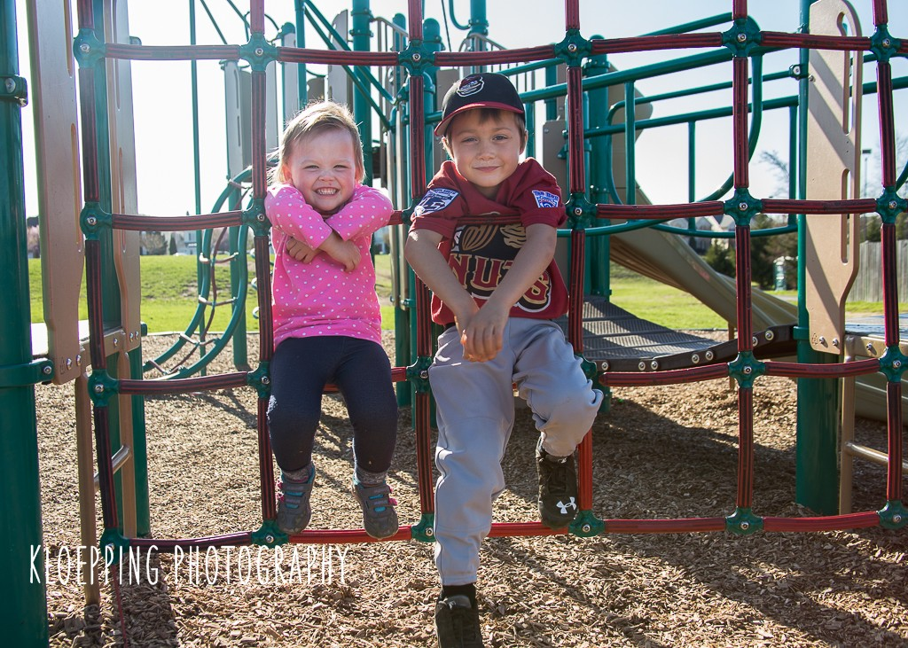 siblings on the play gym