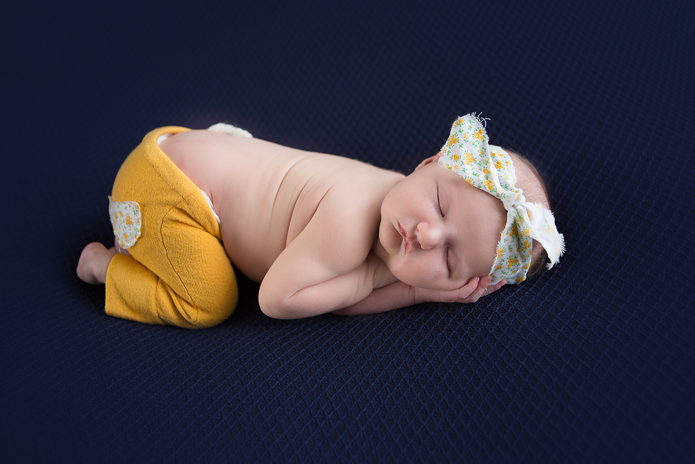 newborn sleeping in blue