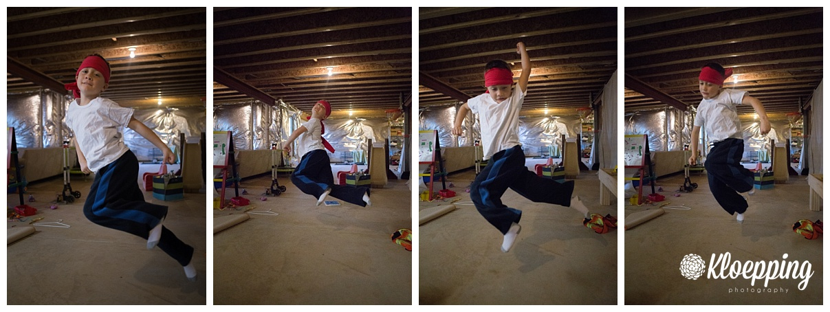 little boy jumping around playing karate
